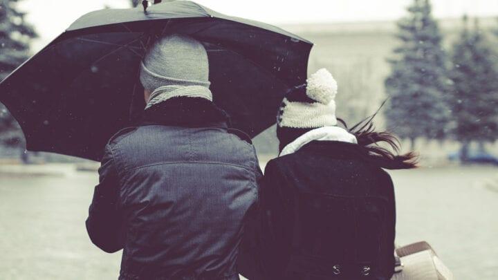 boyfriend sharing umbrella